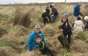 Helping hands: Wetland plant day, Diane Buckley and two pupils from Martinborough Primary School pitch in to help.