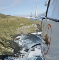 Final drop: Helicopter dropping bait across Antipodes Island.