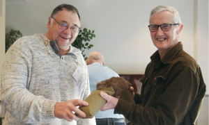 Ken Barnes and Murray Stevenson with a hare dummy used for training gun dogs
