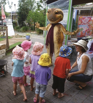 Attention getter: Children at Fox St Pre School, Ballina, get a friendly visitor to celebrate the  launch of WetlandCare Australia's Wetland Discovery Programme.