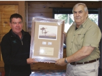 Ian's reward: Andy Garrick CEO of Eastern Fish &Game (left) and DU Life Member Ian Pirani; has also been recognised for his long involvement with Eastern F&G. The inscription says: In recognition of your long term dedication and commitment to the conservation and management of New Zealand's water fowl and their wetland habitats.